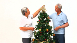 Couple decorating the Christmas tree Stock Video Footage