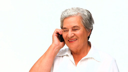 Elderly woman phoning Footage