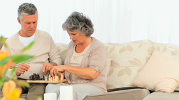 Retired couple playing chess Stock Video Footage
