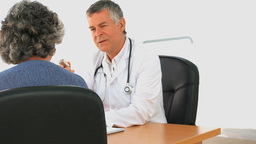 Doctor talking with his female patient Stock Video Footage