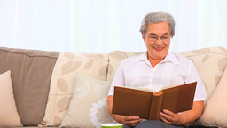 Woman looking at her photo album Footage
