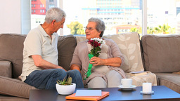 Elderly couple with flowers Stock Video Footage