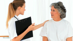 Nurse talking with her senior patient Footage