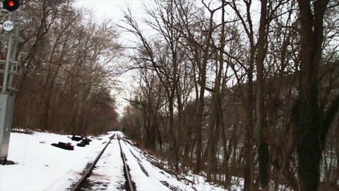 Train Tracks in the Snow, Through Trees Stock Video Footage