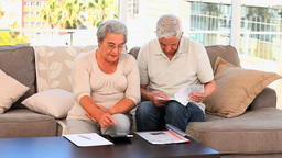 Retired couple calculating their domestics bills Footage