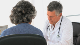 Woman talking with her doctor Footage