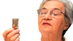 Mature woman looking at her pills Footage