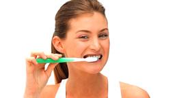 Woman brushing her teeths Footage