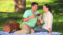 Attractive couple drinking red wine outdoors Footage