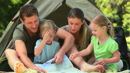 Cute family camping in the countryside Stock Video Footage
