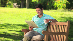 Man reading a newspaper Stock Video Footage