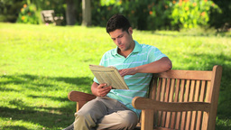 Man reading a newspaper Footage