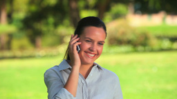 Cute woman on her mobile phone Stock Video Footage
