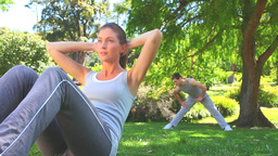 Athletic couple excersising outdoors Stock Video Footage