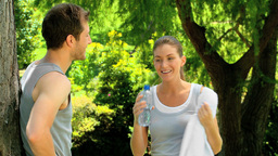 Couple relaxing after jogging Stock Video Footage