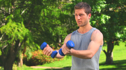 Handsome man doing musculation exercises Footage