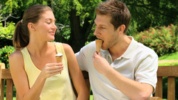 Cute couple eating ice creams Footage