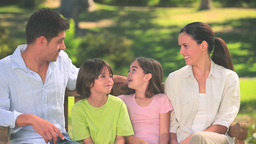 Cute family talking outdoors Footage