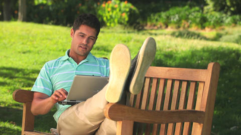 Man using laptop outdoors Footage