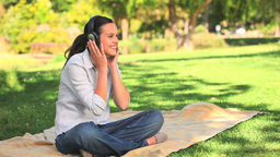 Woman listening to music outdoors Stock Video Footage