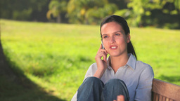 Woman talking on a mobile phone Stock Video Footage
