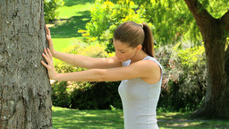 Woman doing streaching exercises outdoors Footage