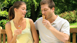 Attractive couple enjoying ice cream Footage