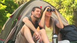 Attractive couple looking through binoculars Footage