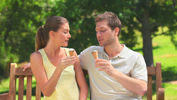 Lovers enjoying ice creams Stock Video Footage