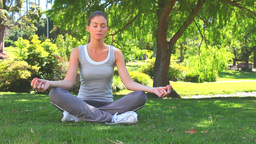 Woman practicing yoga in the lotus position Stock Video Footage