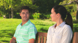 Loving couple sitting on a bench Stock Video Footage