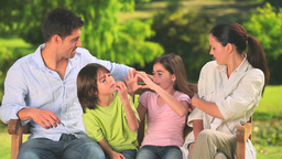Happy family in a park Stock Video Footage