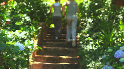 Couple running up a flight of steps Stock Video Footage