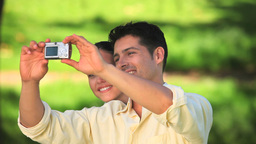 Couple taking a picture of themselves Stock Video Footage