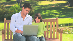 Father and son with laptop outdoors Footage