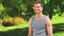 Handsome man using dumbbells outdoors Stock Video Footage