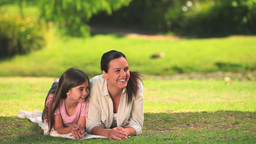 Mother and daughter chatting outdoors Footage