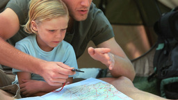 Father explaining how to read a compass Stock Video Footage