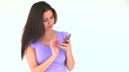 Young woman writing a sms Footage