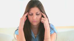 Attractive woman having a headache Stock Video Footage