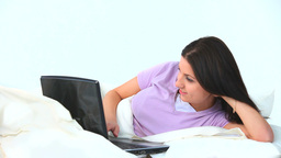 Young woman using her laptop and laughing Footage