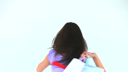 Cute woman showing her shopping Stock Video Footage