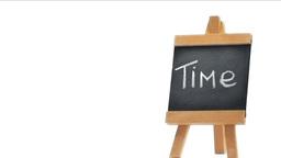 Word Time written on a blackboard Stock Video Footage