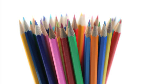 Color pencils rotating in a pencil holder Stock Video Footage