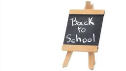 Phrase Back to school written on a blackboard Stock Video Footage
