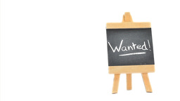 Word Wanted ! written on a blackboard Stock Video Footage