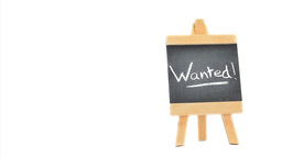 Word Wanted ! written on a blackboard Stock Video Footage