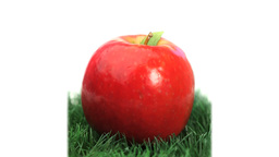 Red apple on grass rotating Footage
