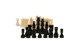 White chess pieces in front of black chess pieces Stock Video Footage