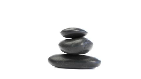Black pebbles rotating Stock Video Footage